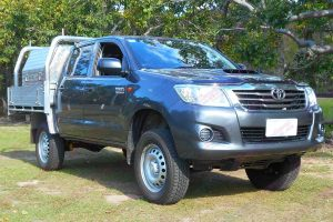 Front right side view of a grey dual cab Toyota Hilux (Vigo) fitted with a heavy duty Dobinson 2 inch lift kit from Superior