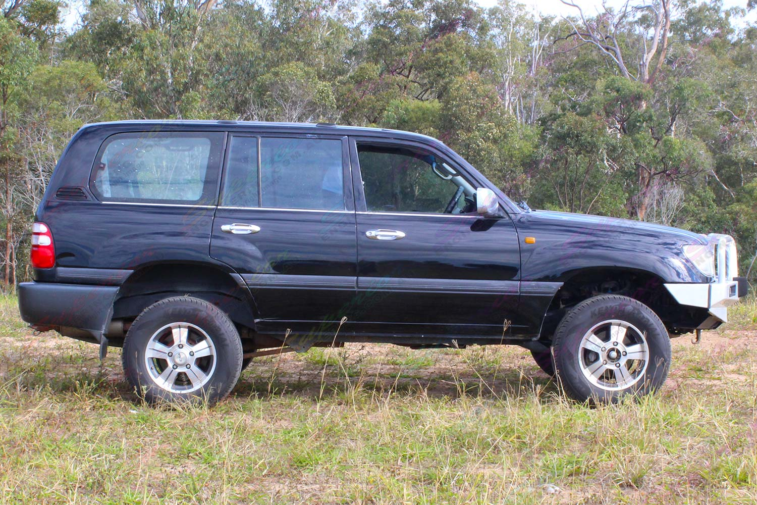 Right side view of a 100 Series Toyota Landcruiser after being fitted with a premium 2 inch Bilstein lift kit with air bags