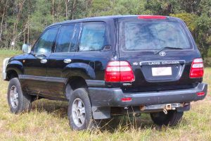 Left rear end view of a V8 100 Series Toyota Landcruiser after being fitted with a premium 2 inch Bilstein lift kit with air bags