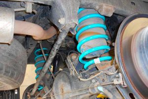 Closeup view of a pair of heavy duty Dobinsons coil springs fitted to a 100 Series Toyota Landcruiser 4wd