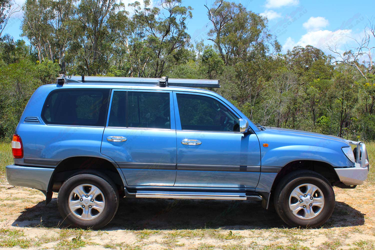 Right side view of a blue 100 Series Toyota Landcruiser after being fitted with a premium 2 inch Bilstein lift kit