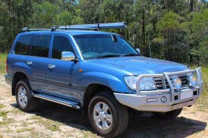 Front right side view of a blue 100 Series Toyota Landcruiser after being fitted with a premium 2 inch Bilstein lift kit from Superior