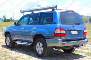 Left rear end view of a blue V8 100 Series Toyota Landcruiser after being fitted with a premium 2 inch Bilstein lift kit from Superior Engineering