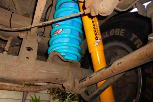 Closeup view of a heavy duty Dobinson shock, coil spring and airbag man coil helper fitted to the rear of a 100 Series Toyota Landcruiser 4wd