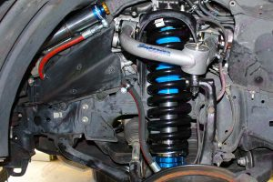 Closeup view of a Profender Adjustable Remote Reservoir Strut, Coil Spring and Superior Upper Control Arm fitted to the front of the 200 Series Toyota Landcruiser