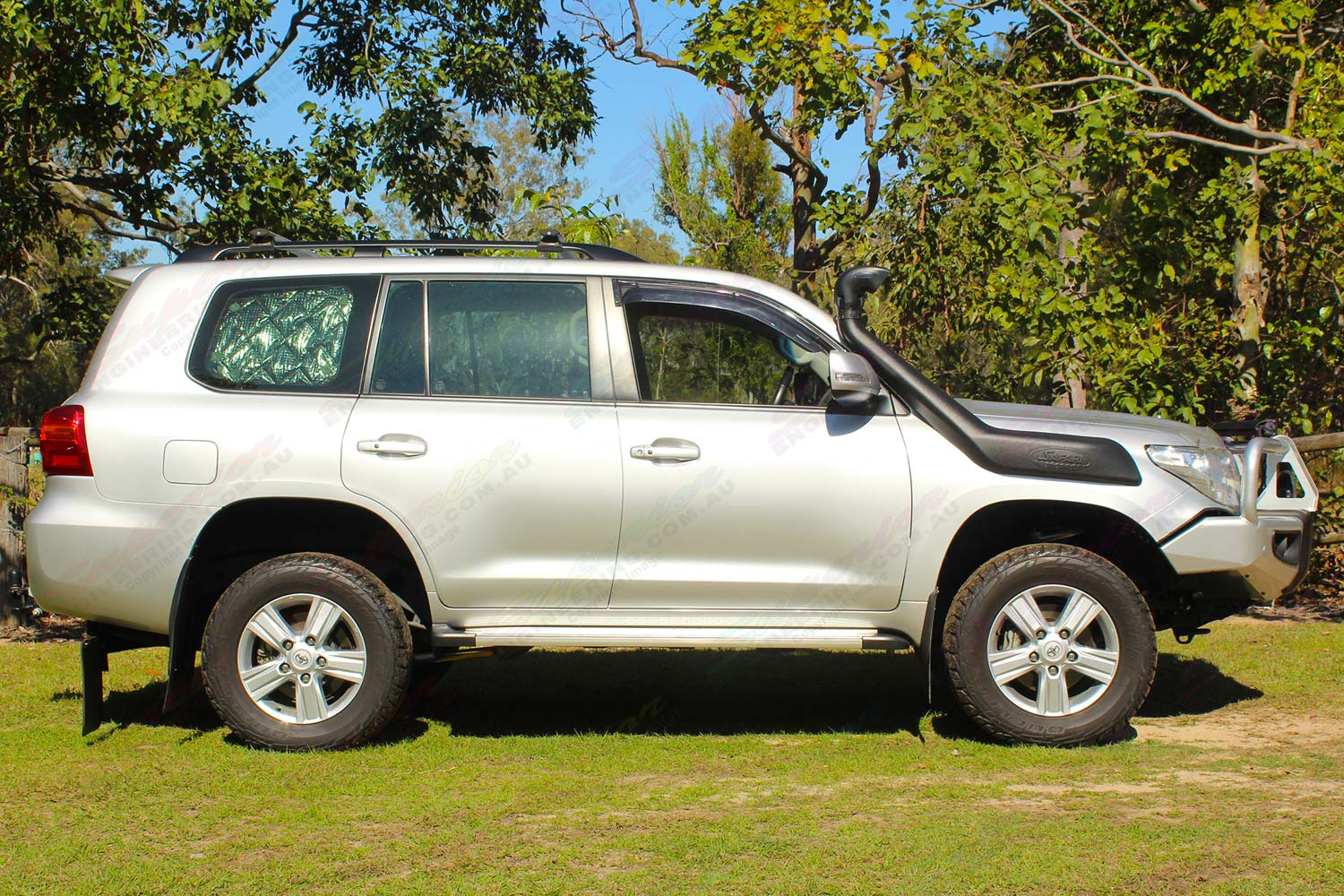 Right side view of a silver 200 Series Toyota Landcruiser after being fitted with a heavy duty 2 inch Profender 4x4 lift kit