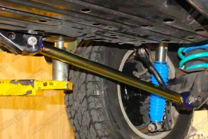 Closeup view of a heavy duty fixed Superior rear lower control arm fitted to the rear of a 200 Series Toyota Landcruiser 4WD