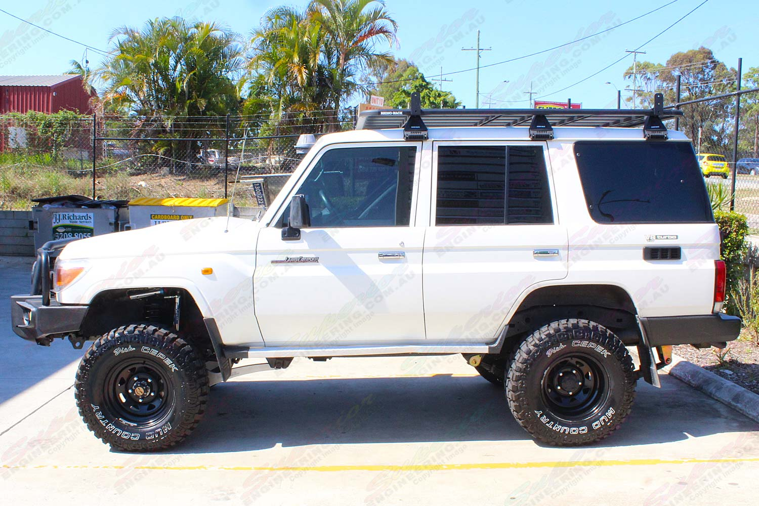 Left side view of a 76 Series Toyota Landcruiser after being fitted with a premium Superior Remote Reservoir Superflex 4 Inch Lift Kit