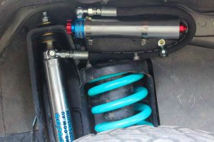 Closeup view of a superior remote res shock absorber and coil spring fitted to the single cab 79 Series Landcruiser ute