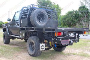 Rear left angle view of the 79 series Toyota Landcruiser (single cab) fitted with the Superior Engineering Remote Reservoir Superflex 5 Inch Lift Kit