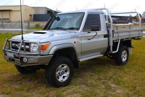 Front left side view of a silver 79 Series Toyota Landcruiser (single cab) ute fitted with 3 inch Superior Nitro Gas lift kit