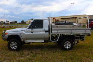 Left side view of a silver 79 Series Toyota Landcruiser (single cab) ute fitted with 3 inch Superior Nitro Gas lift kit