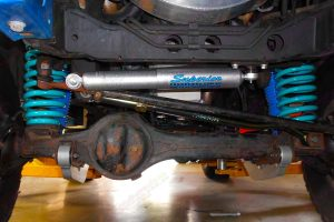 Closeup view of a Superior steering damper, coil springs, radius arms and panhard rod fitted to the front of the 80 Series Toyota Landcruiser
