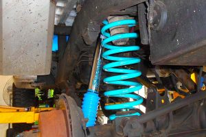 Closeup view of a Superior remote res shock, coil spring and control arm fitted to the rear of the 80 Series Toyota Landcruiser
