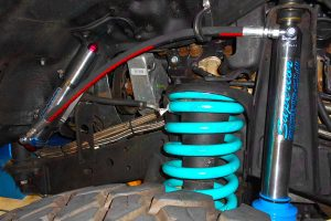 Closeup view of a Superior remote res shock and coil spring fitted to the front of the 80 Series Toyota Landcruiser