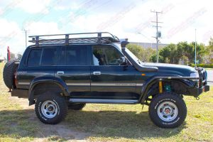 Right side view of a green 80 Series Toyota Landcruiser wagon fitted with dobinsons 4x4 4 inch coil springs and 6 inch shocks
