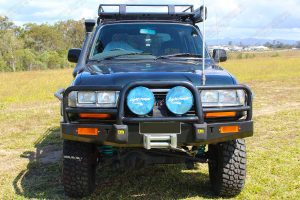 Full front view of the green 80 Series Toyota Landcruiser wagon fitted with dobinsons 4 inch coil springs and 6 inch shocks