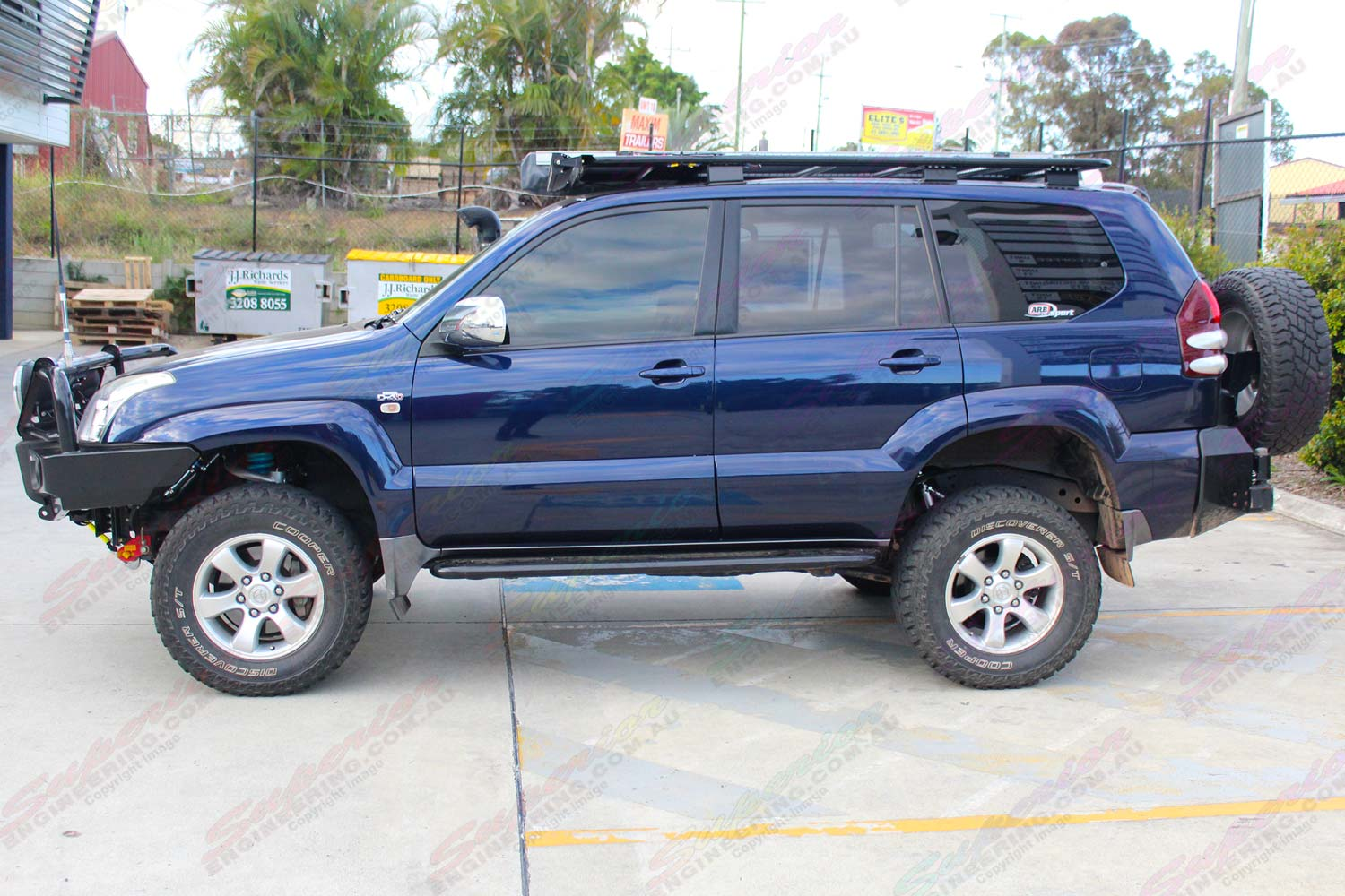 Left side view of the Blue Toyota Prado 120 Wagon after being fitted with a range of Superior, Dobinsons and Profender suspension parts