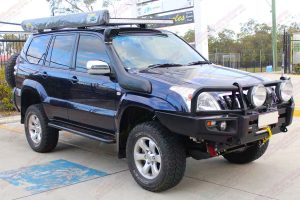 Front right view of the Blue Toyota Prado 120 Wagon after being fitted with a range of Superior, Dobinsons and Profender suspension parts