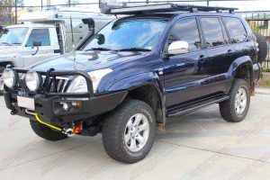 Front left view of the Blue Toyota Prado 120 Wagon after being fitted with a range of Superior, Dobinsons and Profender suspension parts