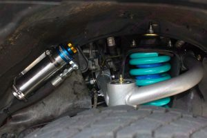 Closeup view of the Superior upper control arm, coil spring and remote res shock fitted to the Prado 120