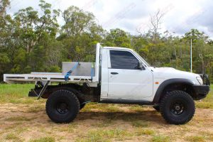 Right side view of a white Nissan Patrol GU Ute fitted with the heavy duty 4 inch Nitro Gas suspension kit