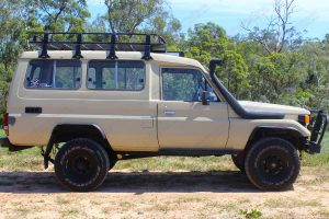 Right side view of a Toyota Landcruiser Troopy HJ75 after being fitted with a heavy duty 2 inch EFS lift kit and a Safari Snorkel