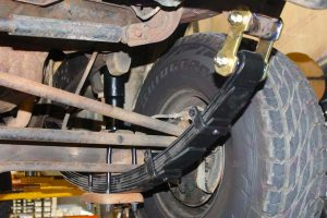 Closeup under vehicle view of a EFS leaf spring, u-bolts and greaseable shackle fitted to the Toyota Landcruiser Troopy HJ75