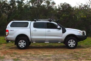 Right side view of a Silver PX Ford Ranger fitted with a range of Superior and Ironman 4x4 accessories