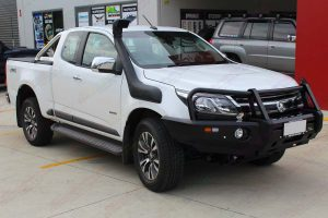 Front right view of a white Holden Colorado Space Cab fitted with a Ironman 4x4 Black Deluxe Bullbar and Airforce Snorkel