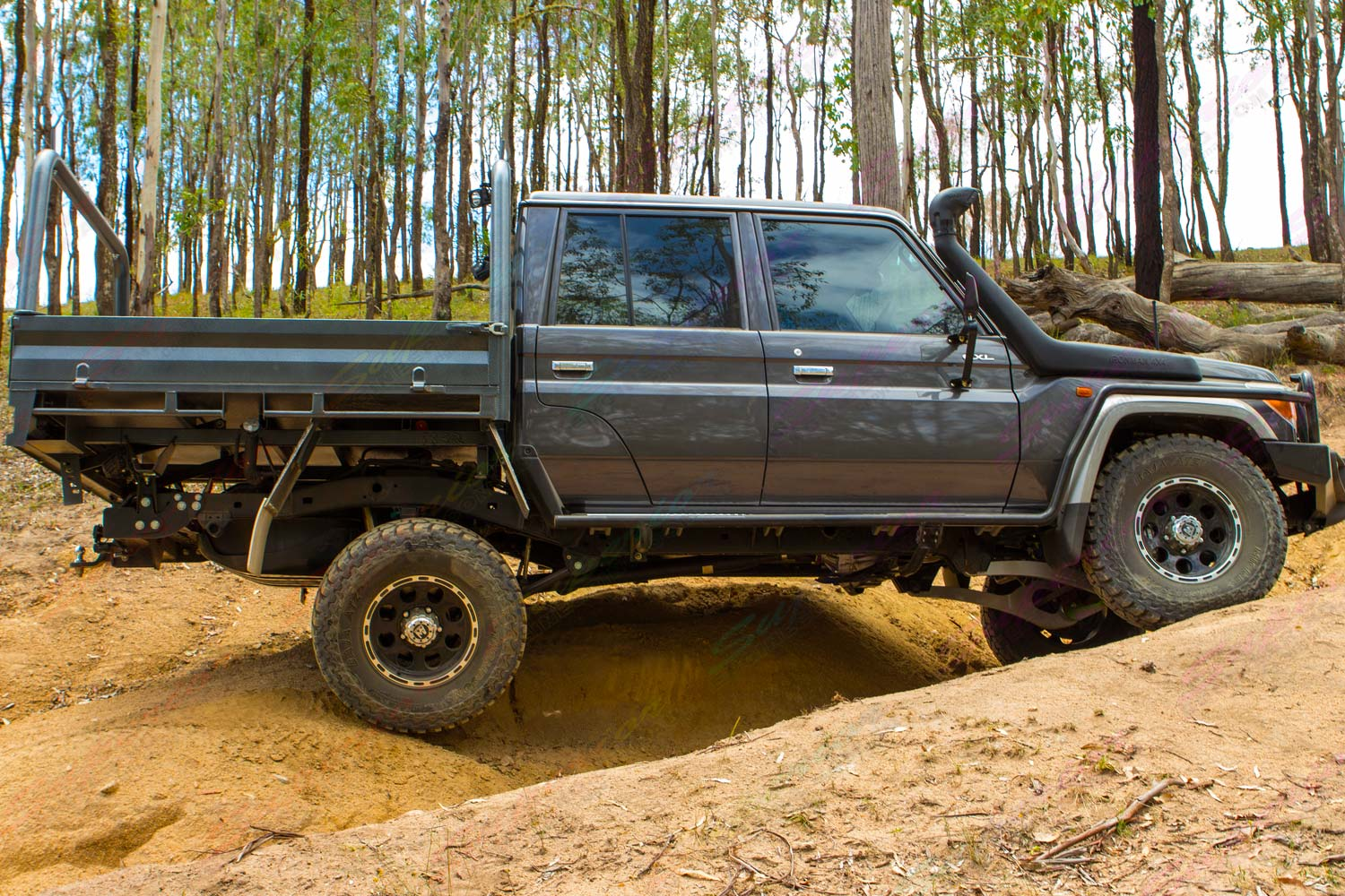 Right side of a dark grey 79 Series Toyota Landcruiser at Landcruiser Mountain Park testing out the new Superior rear coil conversion kit
