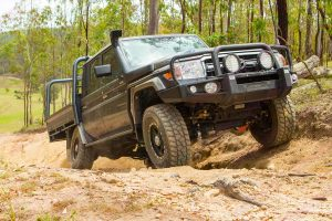 Front view of a VSC 79 Series Toyota Landcruiser (Dual Cab 2016-2017 Model) at Landcruiser Mountain Park powering up one of the tracks