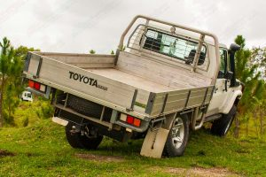 Rear right end view of the single cab 79 Series Toyota Landcruiser (NON VSC Pre 2016 Model) testing out the flex and suspension of the rear coil conversion kit