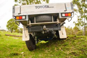 Rear end view of the 79 Series Toyota Landcruiser (single cab) at Superior Engineering testing out the flex of the rear coil conversion suspension kit