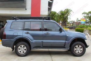 Right side view of a dark grey NP Mitsubishi Pajero wagon fitted out with a 40mm Ironman lift kit