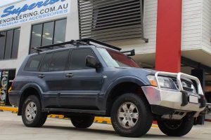 Front right low profile view of the Mitsubishi Pajero fitted out with a 40mm Ironman lift kit out front of the Superior 4x4 showroom