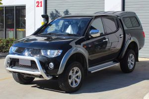Front left view of the ML Triton (Dual Cab) fitted with an Ironman Bullbar, Snorkel, Nitro Gas Shocks and Dobinsons Springs