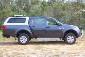 Right side view of a ML Mitsubishi Triton dual cab fitted out with a constant load 40mm Ironman lift kit