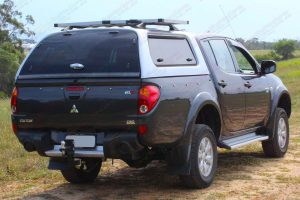 Rear right end view of the ML Triton (dual cab) fitted out with a the heavy duty 40mm Ironman lift kit