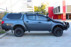 Right side view of a grey MN Mitsubishi Triton (Dual Cab) fitted with an 40mm Ironman lift kit and airforce snorkel