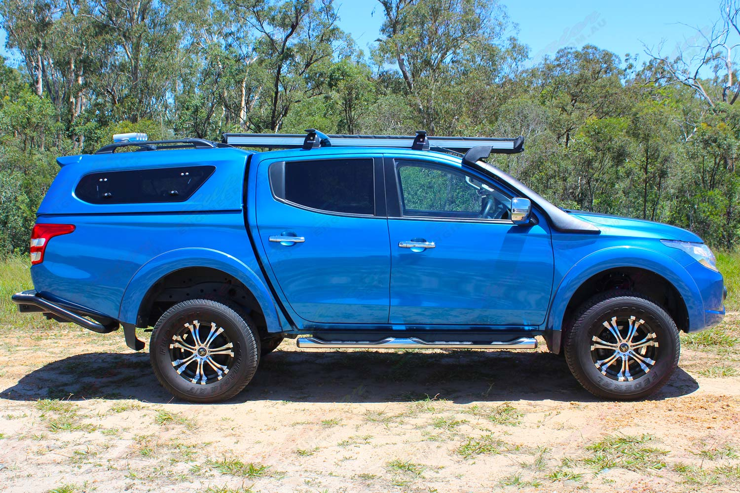 Right side view of the MQ Mitsubishi Triton (dual cab) fitted out with a 40mm Superior Nitro Gas lift kit