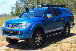 Front left view of the MQ Triton (dual cab) after being fitted with the 40mm Nitro Gas lift kit by Superior Engineering