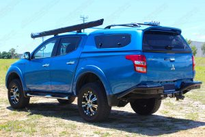 Rear left end view of the MQ Triton (dual cab) after being fitted with the 40mm Nitro Gas lift kit by Superior Engineering