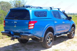 Rear right end view of the blue MQ Triton (dual cab) after being fitted with the 40mm Nitro Gas lift kit by Superior Engineering