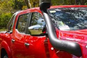 Closeup view of a TJM Airtec Snorkel fitted to a Red NP300 Nissan Navara