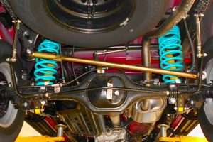 Closeup view of the Superior adjustable panhard rod, swaybar extensions, Dobinson coil springs and shocks fitted to the underside of the NP300