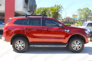 Right side view of an Orange Ford Everest (Wagon) fitted out with a top of the range 40mm Ironman 4x4 lift kit
