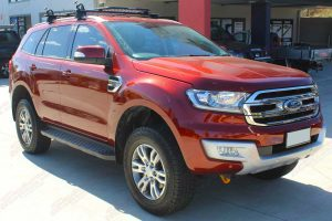 Front right view of an Orange Ford Everest (Wagon) fitted out with our top of the range 40mm Ironman 4x4 lift kit
