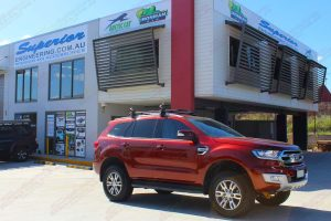 Front right view of the Ford Everest (Wagon) after being fitted with the 40mm Ironman 4x4 lift kit at the front of the Superior 4WD showroom