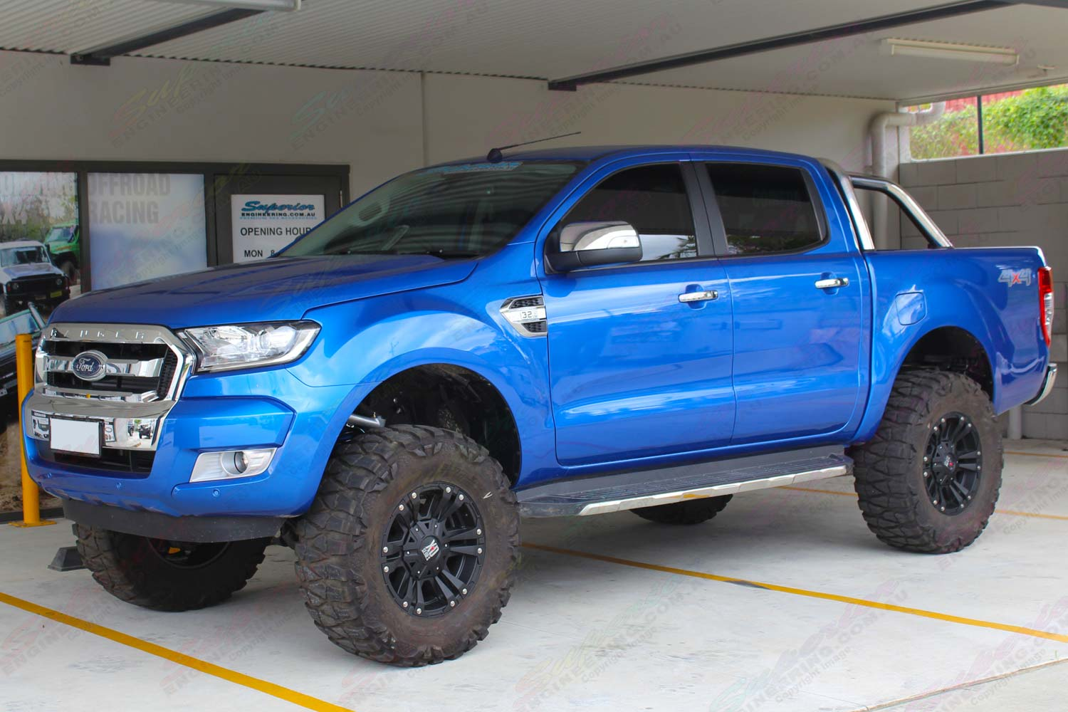 "Left side view of a current model Ford Ranger (PX11) after being fitted with a Superior 5"" inch lift kit"